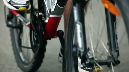 Close up of legs spining on bike