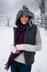 Woman wearing knitwear enjoying snow