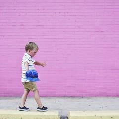 Boy walking on raised sidewalk