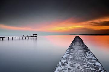 Malaysia, Negeri Sembilan, Teluk Kemang, View of jetty and sea at sunset