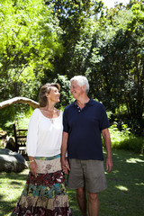 South Africa, Senior couple walking in the garden
