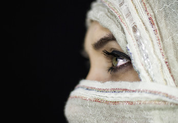 View of girl with face covered