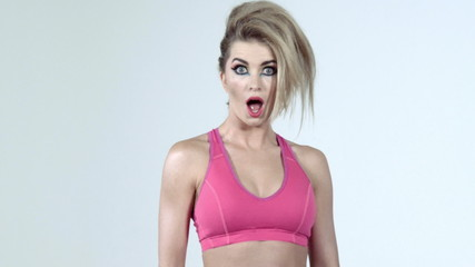 Colourful studio shot of funny surprised woman, slow motion.
