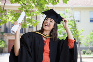 Cape Town, South Africa, Young female graduate holding diploma