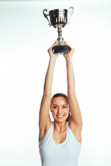 Sportswoman holding up trophy