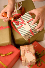 Close-up of woman putting wax seal on Christmas present