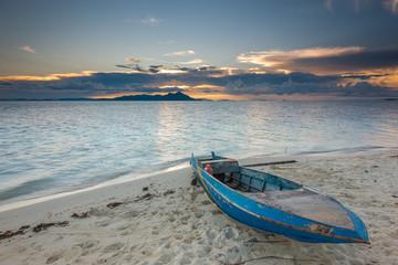 Malaysia, Sabah, Sampan on beach at sunset