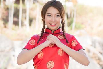 Chinese girl with cheongsam respecting