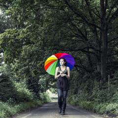 Woman with multicolored umbrella