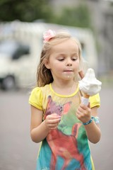 Girl (2-3) eating ice-cream