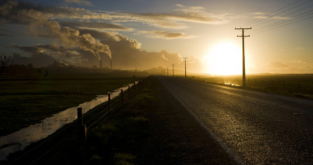New Zealand, West Coast, Cape Foulwinds, Cement factory at sunset