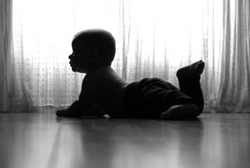 Portrait of baby lying on floor