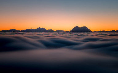 Austria, Mountain peaks above clouds as seen from Gaisberg near Salzburg