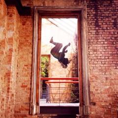 Brazil, Rio de Janeiro, Man executing somersault over railing