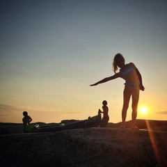 Norway, Children with kayak on rock at sunset