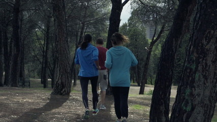 Young people jogging in park