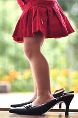 Legs of girl (2-3) in high heels