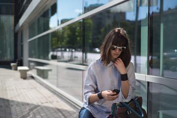 Bulgaria, Sofia, Woman looking at mobile phone