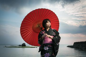Japanese woman in Kimono and traditional umbrella