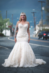 Bride walking along street