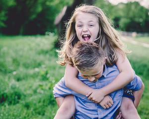 Siblings (8-9, 10-11) enjoying themselves in countryside
