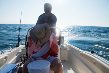 Italy, Puglia, TA, Ginosa, Marina di Ginosa, Men fishing on boat in Italy