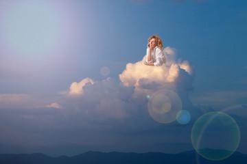 Blonde woman dreaming on cloud