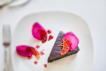 Chocolate dessert garnished with petals