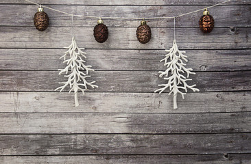 white christmas trees with brown pine cone ornaments