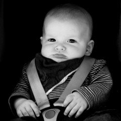 Little baby boy (2-5 months) sitting in car seat