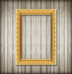 Antique picture frame on wooden wall ;. Empty picture frame on w