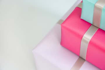 Close up of three gifts on top of each other
