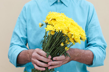 Man holding bunch of flowers