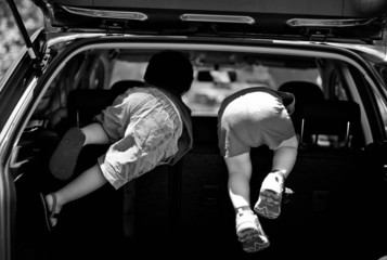 Australia, Kalamunda, Two boys (2-3) playing in back of car