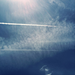 USA, Wisconsin, Kenosha, Airplane trail in sky