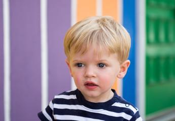 USA, Indiana, Saint Joseph County, Mishawaka, Toddler boy playing by rainbow wall