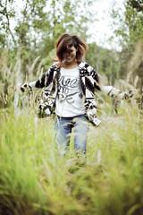 Teenage girl dancing in grass