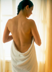Woman wrapped in towel
