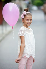 Bulgaria, Happy girl (8-9) holding pink balloon