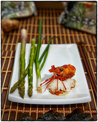 Deep fried shrimp head served with rice, asparagus, and green onions