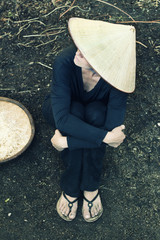 Elevated view of woman wearing asian style conical hat
