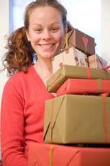 Woman carrying christmas gifts