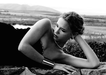 Woman lying on stone wall
