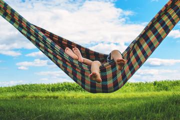 Children (2-3) relaxing in hammock