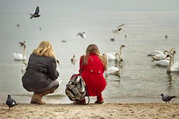 Bulgaria, Varna, Two girls (12-13, 16-17) on beach looking at birds