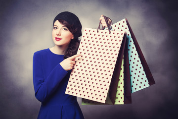 women in blue dress with shopping bags