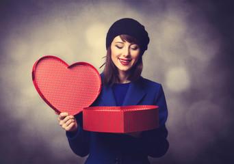 women in blue dress with heart shape gift