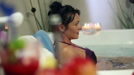 Shot of an older woman soaking in jacuzzi in a fancy hotel