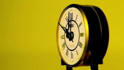 Beatiful antique clock in yellow surroundings