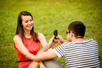 Couple on date - taking photo